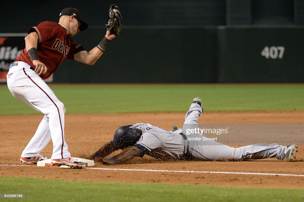 Jose Pirela #2 of the San Diego Padres safely steals third base in front of Jake Lamb #22 of the Arizona Diamondbacks in the sixth inning at Chase Field on September 10, 2017 in Phoenix, Arizona.