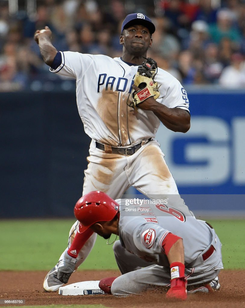 Jose Pirela #2 of the San Diego Padres throws over Billy Hamilton #6 of the Cincinnati Reds as he turns a double play during the seventh inning of a baseball game at PETCO Park on June 2, 2018 in San Diego, California.