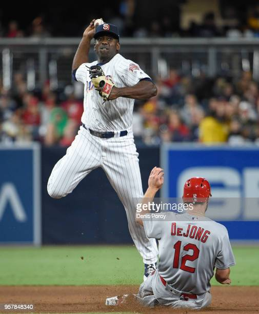 Jose Pirela of the San Diego Padres throws over Paul DeJong of the St Louis Cardinals as he turns a double play during the eighth inning of a...