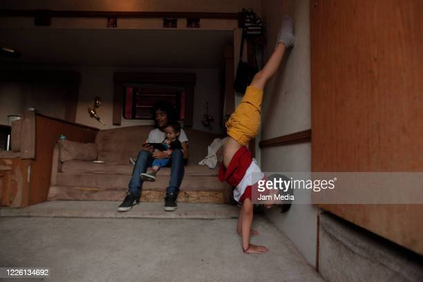 Jose Ponce and his children train circus activities on May 20 2020 in Queretaro Mexico As nonessential activities are not permitted during stage...