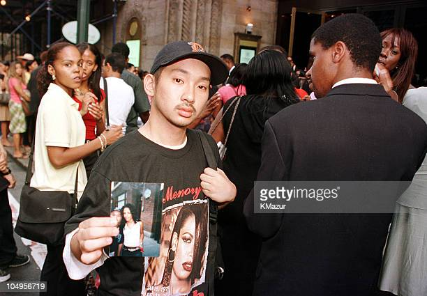 Jose Quarong hold a Aaliyah picture outside Cipriani Restaurant in Midtown Manhattan