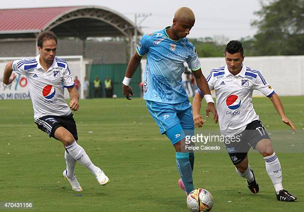 Jose Quinones of Jaguares FC drives the ball as Federico Insua and Omar Vasquez of Millonarios chase him during a match between Jaguares FC and...