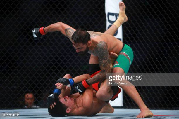Jose Quinonez punches Diego Rivas during the UFC Fight Night Mexico City at Arena Ciudad de Mexico on August 05 2017 in Mexico City Mexico
