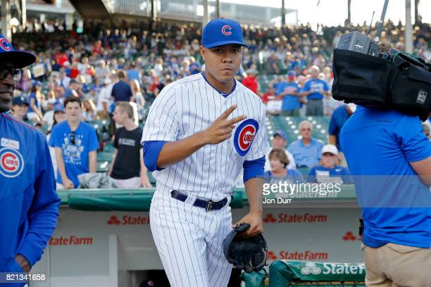 Jose Quintana of the Chicago Cubs gestures as he exits the dugout before warming up for their game against the St Louis Cardinals at Wrigley Field on...