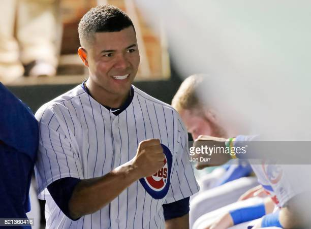 Jose Quintana of the Chicago Cubs is congratulated in the dugout after completing the sixth inning against the St Louis Cardinals at Wrigley Field on...