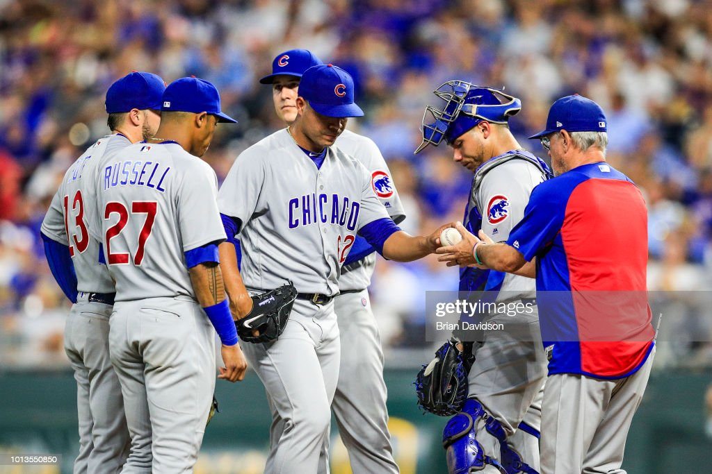 Jose Quintana #62 of the Chicago Cubs is taken out of the game by manager Joe Maddon #70 during the seventh inning against the Kansas City Royals at Kauffman Stadium on August 8, 2018 in Kansas City, Missouri.