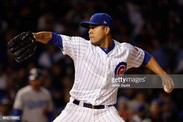 Jose Quintana of the Chicago Cubs pitches in the first inning against the Los Angeles Dodgers during game five of the National League Championship...