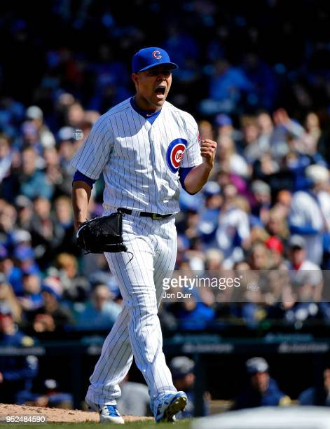 Jose Quintana of the Chicago Cubs reacts after striking out Jonathan Villar of the Milwaukee Brewers to end the seventh inning at Wrigley Field on...