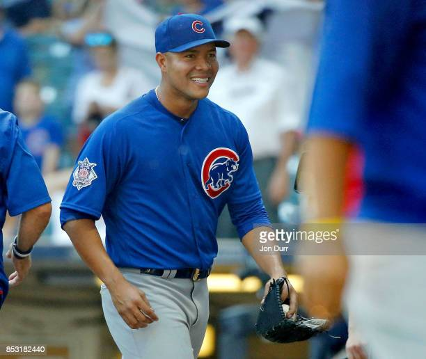 Jose Quintana of the Chicago Cubs smiles after pitching a complete game and shutout against the Milwaukee Brewers at Miller Park on September 24 2017...