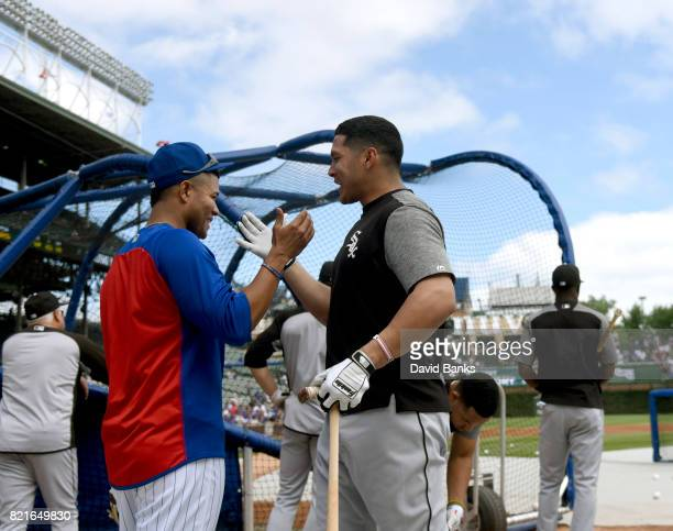 Jose Quintana of the Chicago Cubs visits with his former teammate Avisail Garcia of the Chicago White Sox before the game on July 24 2017 at Wrigley...