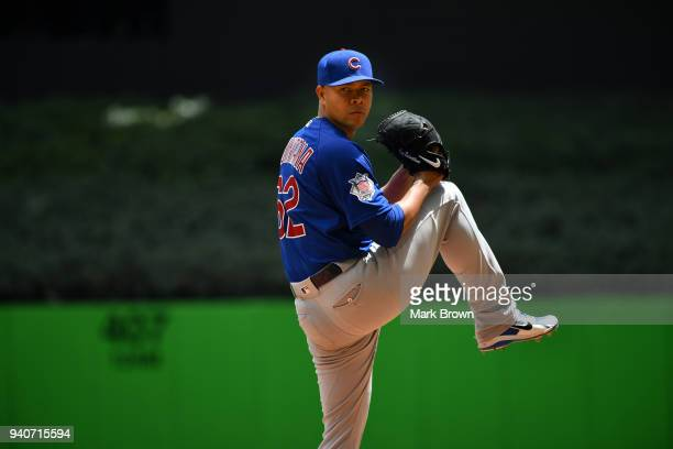 Jose Quintana of the Chicago Cubs warms up in the first inning against the Miami Marlins at Marlins Park on April 1 2018 in Miami Florida