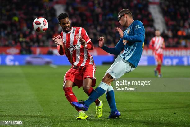 Jose Ramalho of Girona FC competes for the ball with Francisco Montero of Atletcio de Madrid during the Copa del Rey Round of 16 match between Girona...