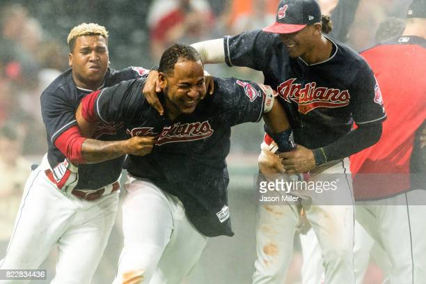 Jose Ramirez and Erik Gonzalez of the Cleveland Indians celebrate with Edwin Encarnacion after Encarnacion hit a walkoff grand slam home run to...