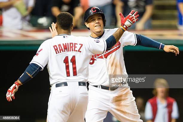 Jose Ramirez and Giovanny Urshela of the Cleveland Indians celebrate after both scored during the second inning against the Kansas City Royals at...