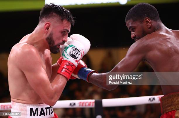 Jose Ramirez and Maurice Hooker during their WBO & WBC Junior Welterweight World Championship fight at College Park Center on July 27, 2019 in...