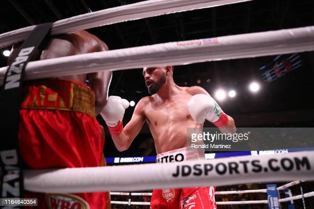 Jose Ramirez and Maurice Hooker in the sixth round during their WBO & WBC Junior Welterweight World Championship fight at College Park Center on July...