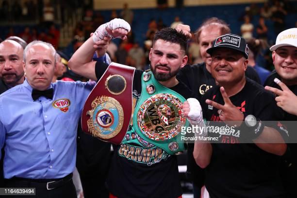 Jose Ramirez celebrates his TKO against Maurice Hooker during their WBO & WBC Junior Welterweight World Championship fight at College Park Center on...