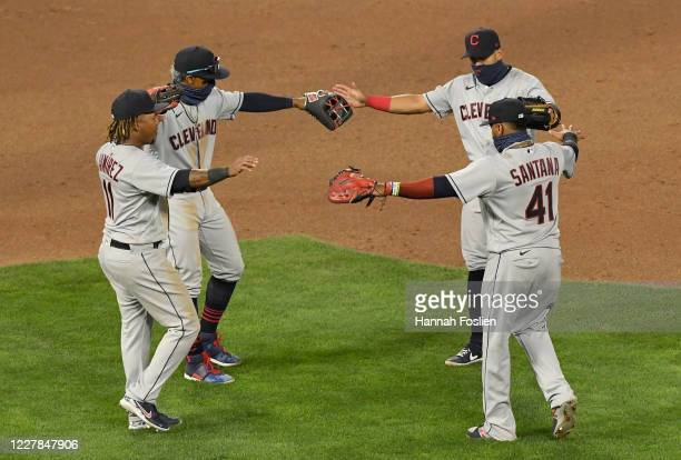 Jose Ramirez Francisco Lindor Cesar Hernandez and Carlos Santana of the Cleveland Indians celebrate defeating the Minnesota Twins in the game at...