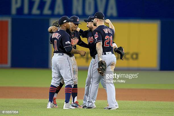 Jose Ramirez Francisco Lindor Jason Kipnis and Mike Napoli of the Cleveland Indians celebrate after defeating the Toronto Blue Jays with a score of 4...