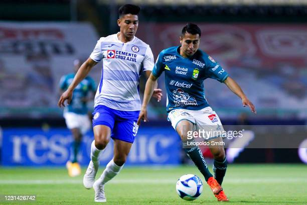 Jose Ramirez of Leon compete for the ball with Guillermo Fernandez of Cruz Azul during the 8th round match between Leon and Cruz Azul as part of the...