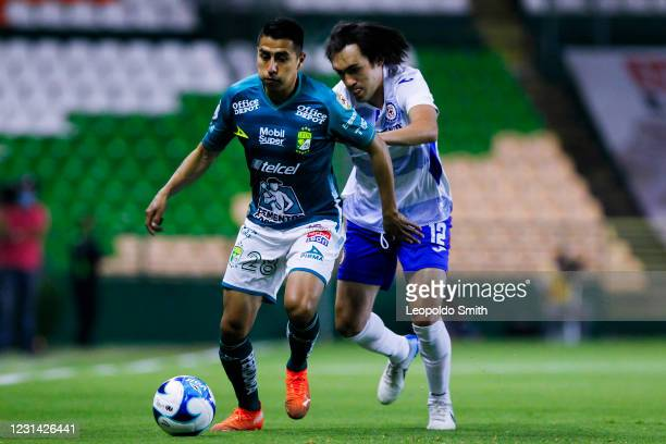 Jose Ramirez of Leon competes for the ball with Jose Martinez of Cruz Azul during the 8th round match between Leon and Cruz Azul as part of the...