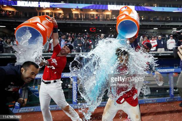 Jose Ramirez of the Cleveland Indians along with his translator are doused with Gatorade after a walkoff tworun home run in the ninth inning against...