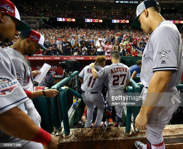 Jose Ramirez of the Cleveland Indians and Jose Altuve of the Houston Astros walk into the dugout during the 89th MLB AllStar Game at Nationals Park...