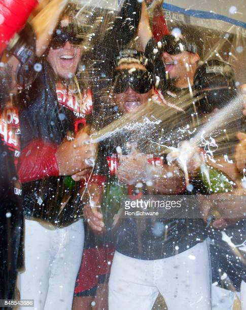 Jose Ramirez of the Cleveland Indians and teamates celebrate winning the American League Central Division championship after beating the Kansas City...