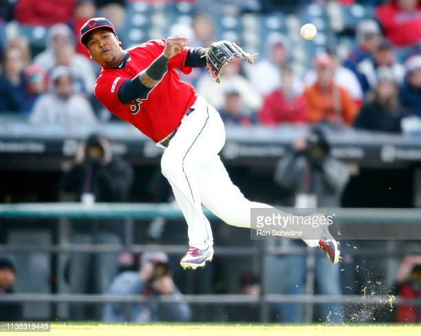 Jose Ramirez of the Cleveland Indians attempts to throw out Josh Donaldson of the Atlanta Braves during the third inning of Game 1 of a doubleheader...