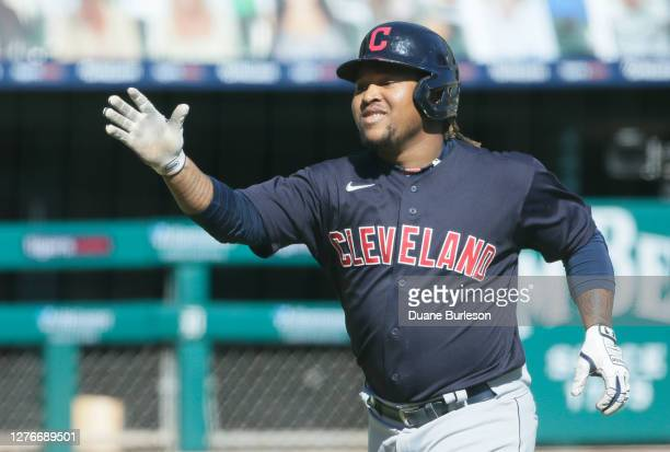 Jose Ramirez of the Cleveland Indians celebrates after scoring against the Detroit Tigers at Comerica Park on September 20 in Detroit Michigan