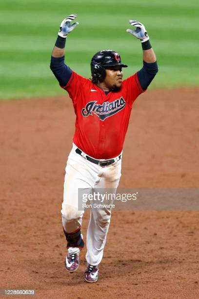 Jose Ramirez of the Cleveland Indians celebrates as he rounds the bases after hitting a walk-off three-run home run off José Ruiz of the Chicago...