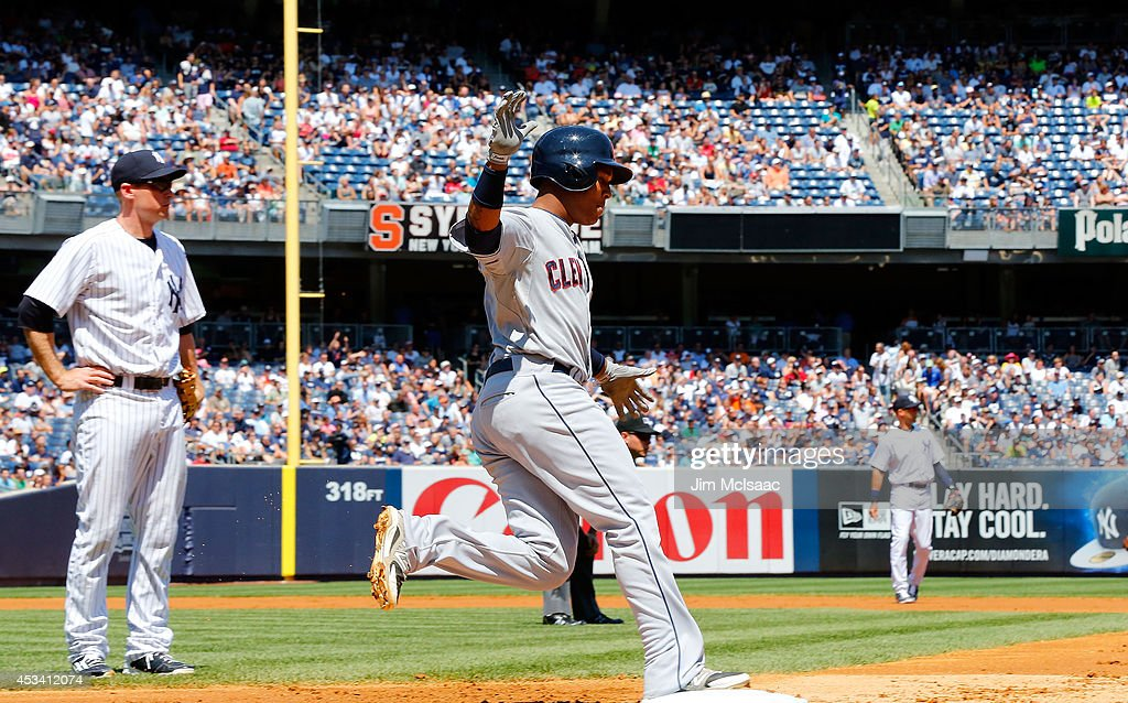Jose Ramirez #11 of the Cleveland Indians celebrates his second inning two run home run against the New York Yankees at Yankee Stadium on August 9, 2014 in the Bronx borough of New York City.