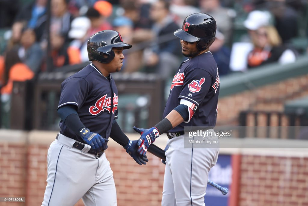 Jose Ramirez #11 of the Cleveland Indians celebrates hitting a solo home run in the sixth inning with Edwin Encarnacion #10 during a baseball game against the Baltimore Orioles at Oriole Park at Camden Yards on April 21, 2018 in Baltimore, Maryland.