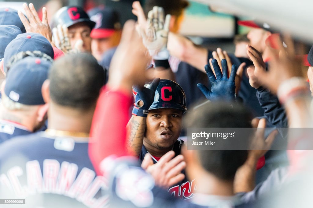 Jose Ramirez #11 of the Cleveland Indians celebrates in the dugout after hitting a two run home run during the first inning against the San Diego Padres at Progressive Field on JULY 6, 2017 in Cleveland, Ohio.