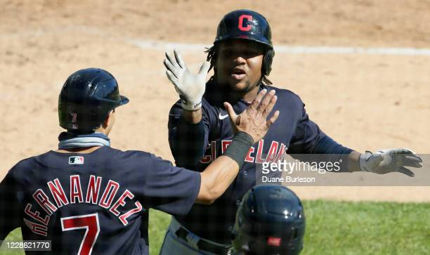 Jose Ramirez of the Cleveland Indians celebrates with Cesar Hernandez after hitting a tworun home run that scored the pair during the sixth inning of...