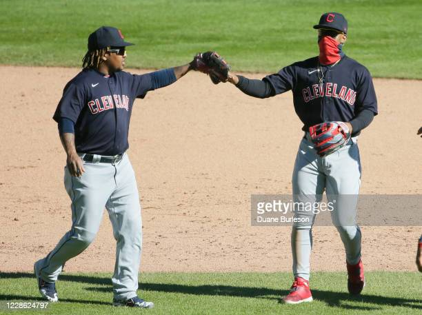 Jose Ramirez of the Cleveland Indians celebrates with Francisco Lindor after a 74 win over the Detroit Tigers at Comerica Park on September 20 in...