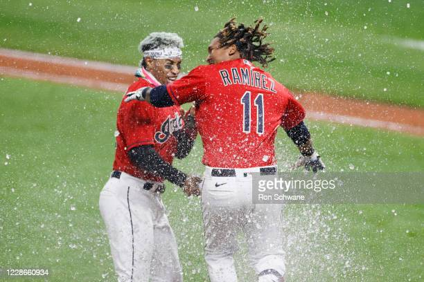 Jose Ramirez of the Cleveland Indians celebrates with Francisco Lindor after hitting a walk-off three-run home run off José Ruiz of the Chicago White...