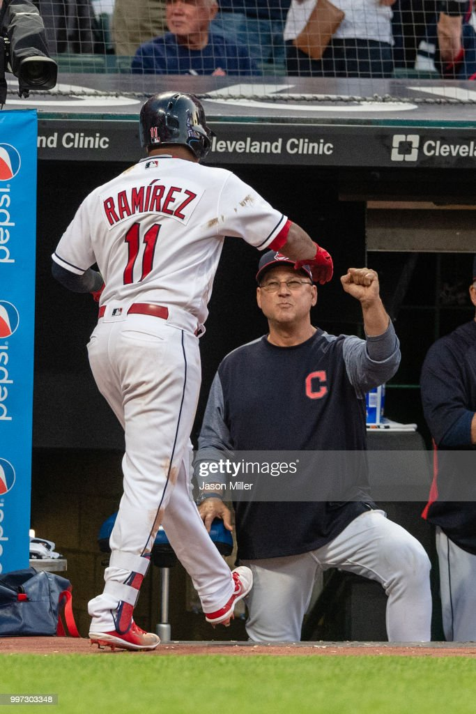 Jose Ramirez #11 of the Cleveland Indians celebrates with manager Terry Francona #77 after hitting a solo home run to right during the fifth inning against the New York Yankees at Progressive Field on July 12, 2018 in Cleveland, Ohio.