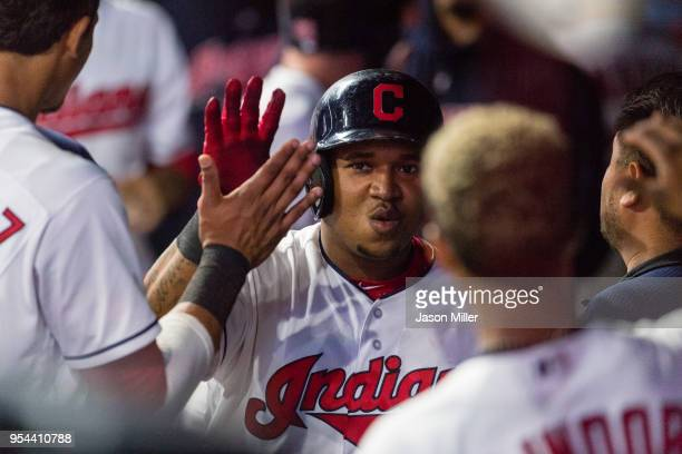 Jose Ramirez of the Cleveland Indians celebrates with teammates after scoring during the fifth inning against the Toronto Blue Jays in game two of a...