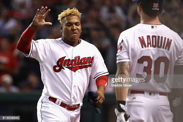Jose Ramirez of the Cleveland Indians celebrates with Tyler Naquin after scoring a run in the second inning against the Boston Red Sox during game...