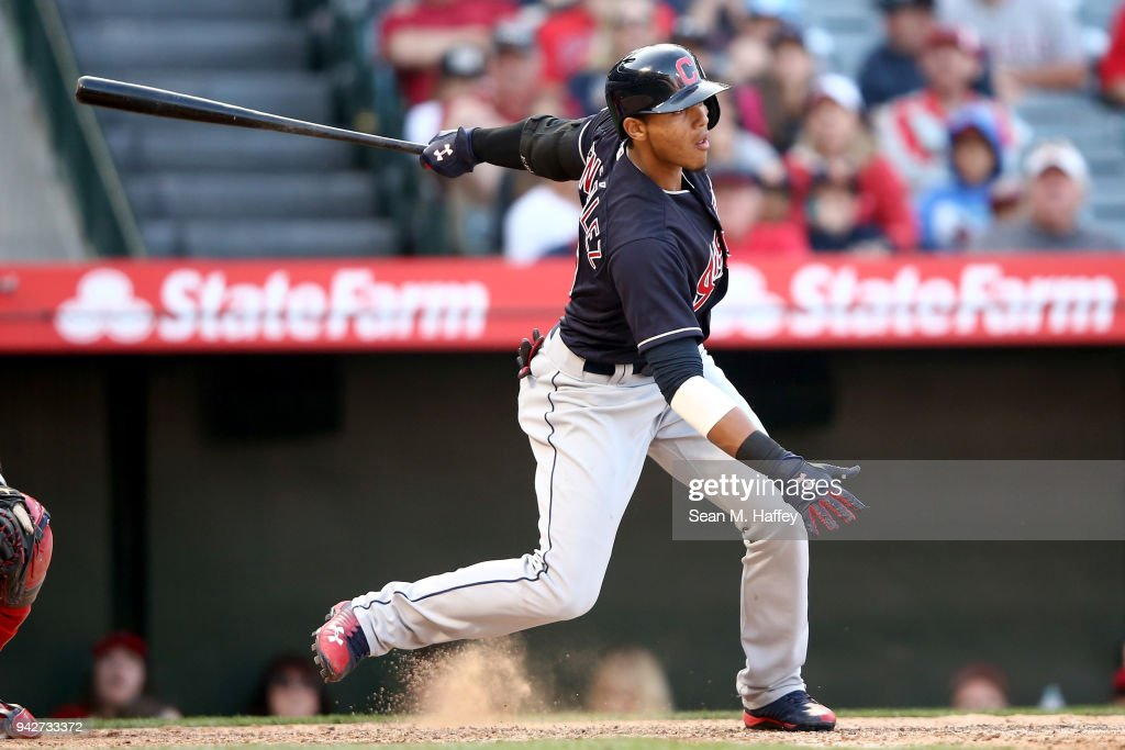 Jose Ramirez #11 of the Cleveland Indians flys out during a game against the Los Angeles Angels of Anaheim at Angel Stadium on April 4, 2018 in Anaheim, California.