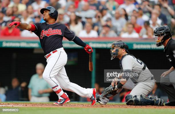 Jose Ramirez of the Cleveland Indians hits a solo home run against the New York Yankees in the first inning at Progressive Field on July 14 2018 in...