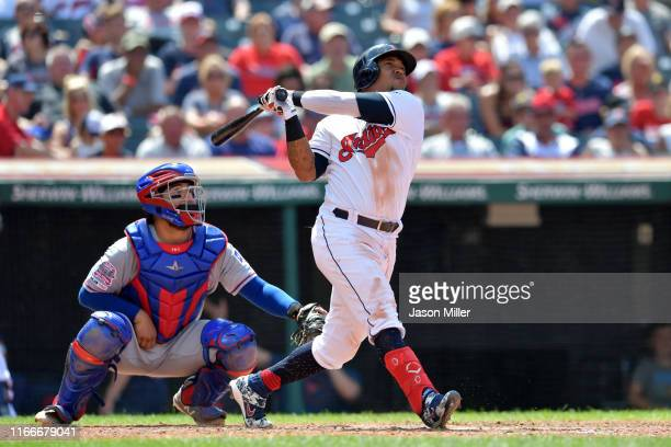 Jose Ramirez of the Cleveland Indians hits a two run homer during the seventh inning of game one of a double header against the Texas Rangers at...