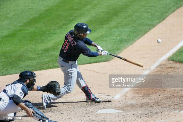 Jose Ramirez of the Cleveland Indians hits a tworun home run with catcher Austin Romine of the Detroit Tigers behind the plate during the sixth...