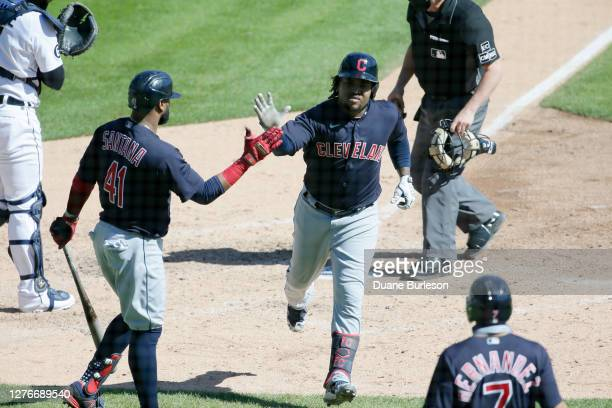 Jose Ramirez of the Cleveland Indians is congratulated by Carlos Santana after hitting a home run against the Detroit Tigers at Comerica Park on...