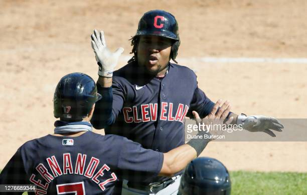Jose Ramirez of the Cleveland Indians is congratulated by Cesar Hernandez after hitting a home run against the Detroit Tigers at Comerica Park on...