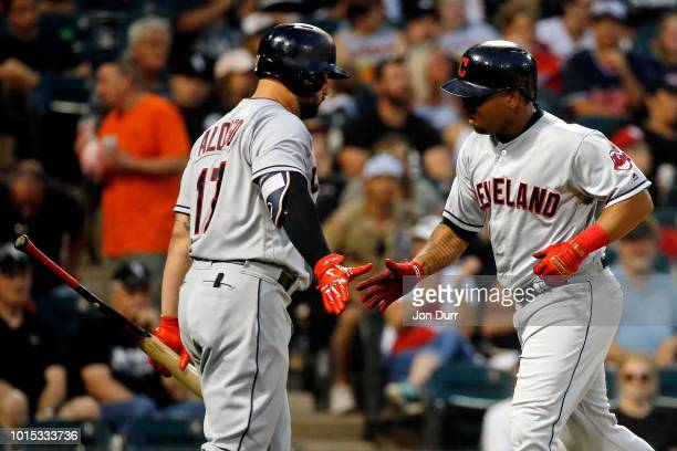 Jose Ramirez of the Cleveland Indians is congratulated by Yonder Alonso after hitting a home run against the Chicago White Sox during the sixth...