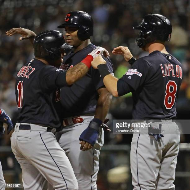 Jose Ramirez of the Cleveland Indians is greeted by teammates Yasiel Puig and Jordan Luplow after hitting a grand slam home run in the 1st inning...
