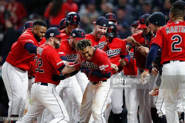 Jose Ramirez of the Cleveland Indians is mobbed by teammates at home plate after hitting a walkoff tworun home run in the ninth inning against the...