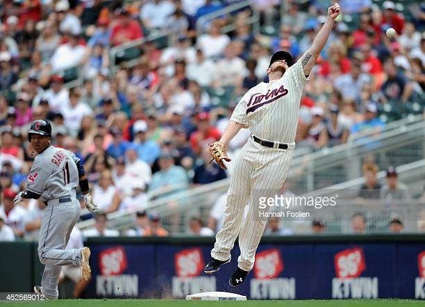 Jose Ramirez of the Cleveland Indians is safe at first base as Chris Parmelee of the Minnesota Twins is unable to field the ball during the eighth...